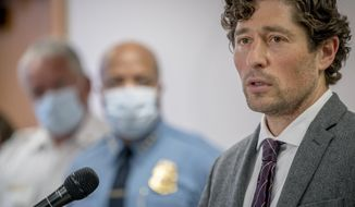Minneapolis Mayor Jacob Frey speaks during a news conference Thursday, May 28, 2020 in Minneapolis, Minn. Violent protests over the death of a black man in police custody rocked a Minneapolis neighborhood for a second straight night as angry crowds looted stores, set fires and left a path of damage that stretched for miles. The mayor asked the governor to activate the National Guard. (Elizabeth Flores/Star Tribune via AP)