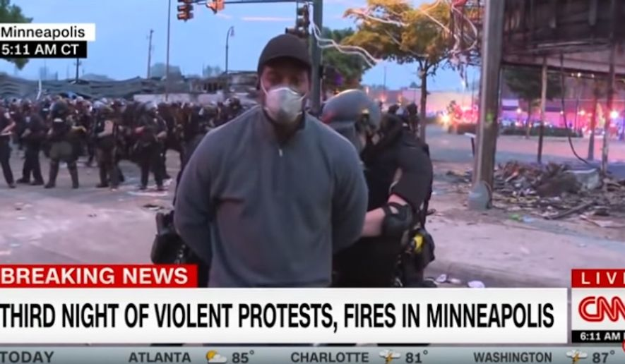 Minnesota Gov. Tim Walz apologized Friday, May 29, 2020, to CNN president Jeff Zucker after several CNN crew members, including reporter Omar Jimenez, were arrested during a live broadcast in Minneapolis. (screen grab via CNN)
