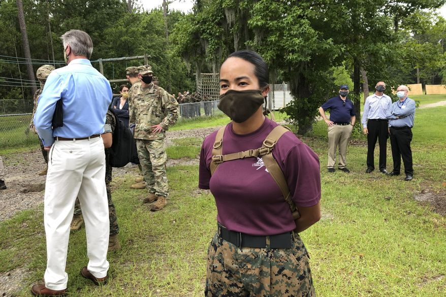 Staff Sgt. Katheryn Hunter, a Marine drill instructor at Parris Island Recruit Depot in South Carolina, poses for a photo on May 27, 2020. In ways big and small, the virus is impacting training at the Marine Corps' Parris Island Recruit Depot and across the military. Hunter, a drill instructor for three years at Parris Island, said the main difference she sees due to the virus is that the number of female recruits she has in 4th Battalion, Oscar Company, has dropped to 70.(AP Photo/Lolita Baldor)