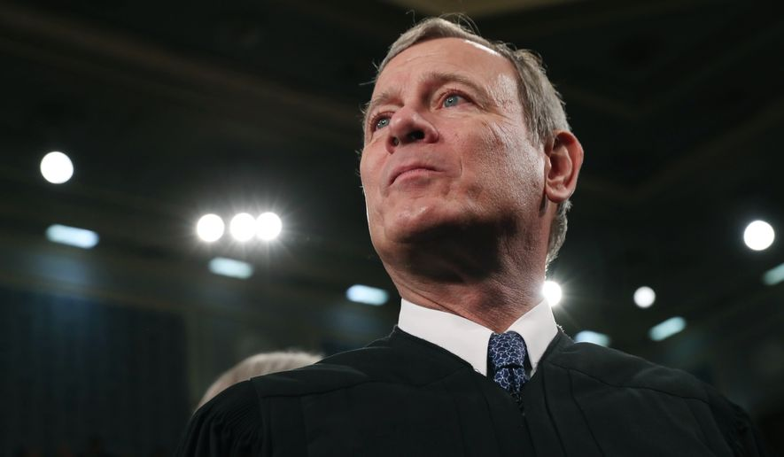 In this Tuesday, Feb. 4, 2020, file photo, Supreme Court Chief Justice John G. Roberts Jr. arrives before President Donald Trump delivers his State of the Union address to a joint session of Congress on Capitol Hill in Washington. (Leah Millis/Pool via AP, File)
