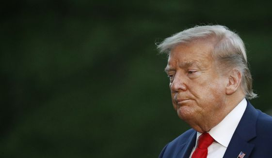 President Donald Trump walks across the South Lawn of the White House in Washington, Saturday, May 30, 2020, after stepping off Marine One as he returns from Kennedy Space Center for the SpaceX Falcon 9 launch. (AP Photo/Patrick Semansky)