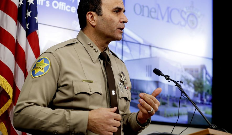 FILE - This Feb. 14, 2019, file photo shows Maricopa County Sheriff Paul Penzone at a news conference in Phoenix. A report on traffic enforcement by sheriff's deputies in metro Phoenix during 2019 has found that stops of Hispanic and black drivers were more likely to last longer and result in searches than those of white drivers. The Maricopa County Sheriff's Office was required to produce the study as one of the remedies to a 2013 ruling that concluded its officers had racially profiled Latinos in then-Sheriff Joe Arpaio's immigration patrols. (AP Photo/Matt York, File)