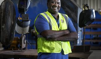 """In this May 25, 2020 photo, former pro wrestler Jimmy """"King Cobra"""" Kimble poses at Republic Services welding in Memphis, Tenn. Kimble, who has worked full-time in the welding shop since 1965, also wrestled with the likes of Jerry """"The King"""" Lawler, The Junkyard Dog, and Hulk Hogan in his spare time. He is getting set to retire from his Republic Services welding shop manager position. (Mark Weber/Daily Memphian via AP)"""
