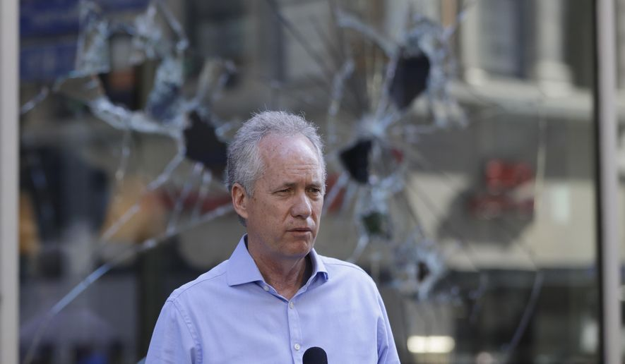 Louisville Mayor Greg Fischer speaks during a news conference, Saturday, May 30, 2020, in Louisville, Ky. (AP Photo/Darron Cummings)