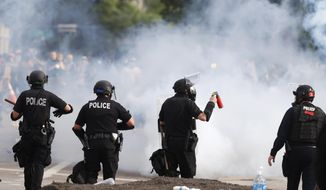 Denver Police move during a protest outside the State Capitol over the death of George Floyd, Saturday, May 30, 2020, in Denver. Protests were held throughout the country over the death of Floyd, a black man who died after being restrained by Minneapolis police officers on May 25. (AP Photo/David Zalubowski)