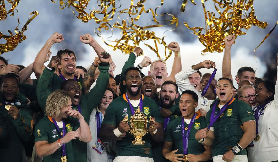 FILE  - In this Saturday, Nov. 2, 2019 file photo, South African captain Siya Kolisi holds the Webb Ellis Cup aloft after South Africa defeated England to win the Rugby World Cup final at International Yokohama Stadium in Yokohama, Japan. The South African government maintained a ban on all contact sports competitions on Saturday, May 30, 2020 because of the coronavirus, meaning the country's professional rugby teams and its world champion Springboks will remain out of action for now. (AP Photo/Christophe Ena, File)