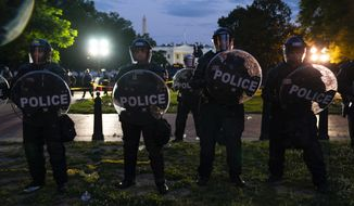 United States Park Police stand near the White House during a protest over the death of George Floyd, Saturday, May 30, 2020, near the White House in Washington. Floyd died after being restrained by Minneapolis police officers. '(AP Photo/Evan Vucci)