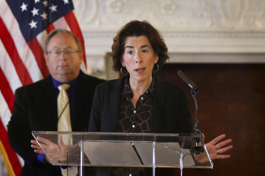 """FILE - In this Sunday, March 22, 2020, file photo, Gov. Gina Raimondo gives an update on the coronavirus during a news conference, in Providence, R.I. Many states have yet to spend the federal funding they got to help with soaring costs related to the coronavirus crisis, making it tougher for states and cities to argue that they need hundreds of billions more from U.S. taxpayers. """"If I knew today that another billion dollars was coming to Rhode Island to help solve our budget deficit, I'd spend the $1.25 billion now,"""" Raimondo said about the state's portion of money. """"Lots of other governors are spending. They're taking a gamble, and I'm just not ready to do that yet."""" (Kris Craig/Providence Journal via AP, Pool, File)"""