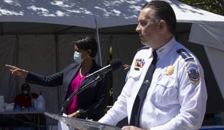 District of Columbia Mayor Muriel Bowser, left, next to Metropolitan Police Department Chief Peter Newsham, calls on a reporter, Monday, June 1, 2020, in Washington, during a news conference. (AP Photo/Jacquelyn Martin) ** FILE **