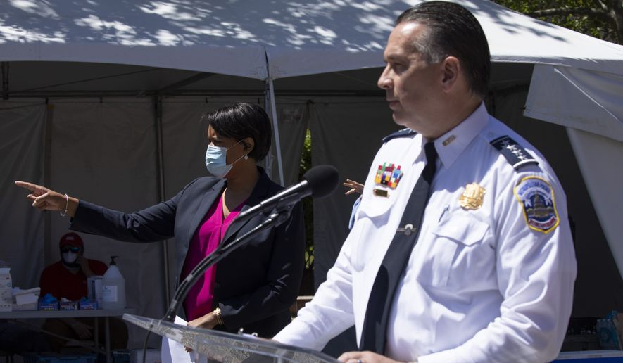 District of Columbia Mayor Muriel Bowser, left, next to Metropolitan Police Department Chief Peter Newsham, calls on a reporter, Monday, June 1, 2020, in Washington, during a news conference to announce a new 7 p.m. curfew for the city for the next two nights. Across the United States people gathered to protest the death of George Floyd, who was killed in police custody in Minneapolis on May 25. (AP Photo/Jacquelyn Martin)