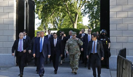 President Donald Trump departs the White House to visit outside St. John's Church, Monday, June 1, 2020, in Washington. Part of the church was set on fire during protests on Sunday night. (AP Photo/Patrick Semansky)