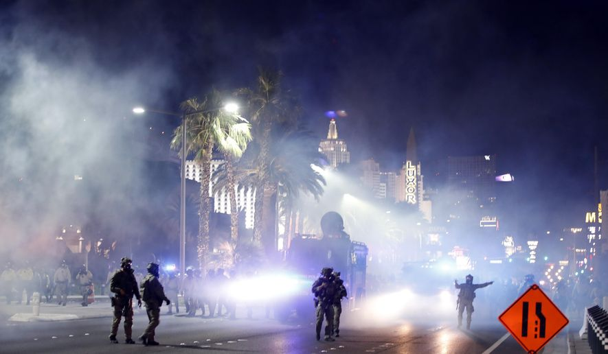 Las Vegas Police disperse protesters with gas on the Las Vegas Strip on Sunday, May 31, 2020, in Las Vegas, during demonstrations over the death of George Floyd, who died May 25 after he was pinned at the neck by a Minneapolis police officer. (AP Photo/Steve Marcus)