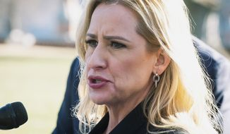 """FILE - In this Jan. 22, 2020, file photo, Arkansas Attorney General Leslie Rutledge speaks to reporters at a news conference in Washington. U.S. District Judge Kristine Baker ruled the use of midazolam in lethal injections is constitutional and dismissed claims that less painful methods of execution are available. Rutledge hailed Baker's decision. """"As the attorney general, I enforce the laws in the state and bring justice for families who have long been devastated at the hands of these murderers,"""" Rutledge, a Republican, said in a statement. """"Today's final judgment reaffirms the constitutionality of Arkansas's execution protocol."""" (AP Photo/Cliff Owen, File)"""