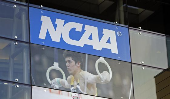 """FILE - In this April 25, 2018, file photo, the NCAA headquarters is shown in Indianapolis. More than a dozen national associations in various sports – hockey, soccer, tennis, golf, swimming and gymnastics, among them – have signed a memo outlining """"significant concerns"""" about effects of allowing athletes to profit for use of their names, images and likenesses (NIL). (AP Photo/Darron Cummings, File)"""