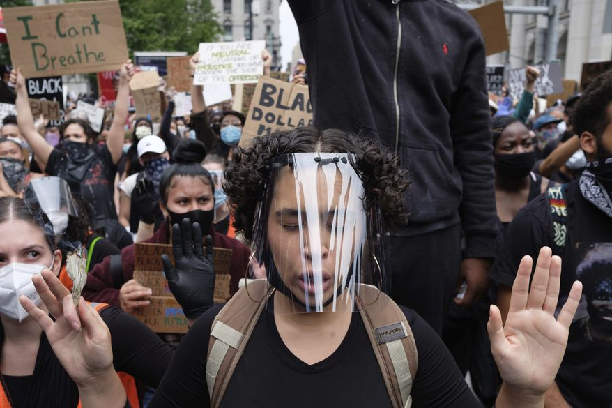 Protesters gather at Foley Square as part of a demonstration to protest the death of George Floyd, who died May 25 after he was pinned at the neck by a Minneapolis police officer, Tuesday, June 2, 2020, in New York. (AP Photo/Yuki Iwamura)