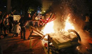 Demonstrators start a fire as they protest the death of George Floyd, Sunday, May 31, 2020, near the White House in Washington. Floyd died after being restrained by Minneapolis police officers (AP Photo/Alex Brandon)