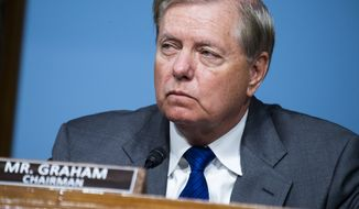 Chairman Lindsey Graham, R-S.C., listens during a Senate Judiciary Committee hearing examining issues facing prisons and jails during the coronavirus pandemic on Capitol Hill in Washington, Tuesday,  June 2, 2020. (Tom Williams/CQ Roll Call/Pool via AP)