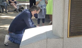 In this image courtesy of KOVR CBS13 Sacramento, California Gov. Gavin Newsom cleans up graffiti left from protests Tuesday, June 2, 2020, in Sacramento, Calif. (Jeff Bell/KOVR CBS13 Sacramento via AP)