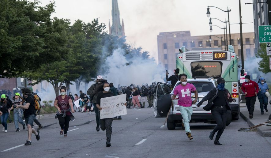 Detroit police fire tear gas at protesters during the third day of protesting police brutality and justice for George Floyd Sunday May 31, 2020 in Detroit. (Nicole Hester/Ann Arbor News via AP)