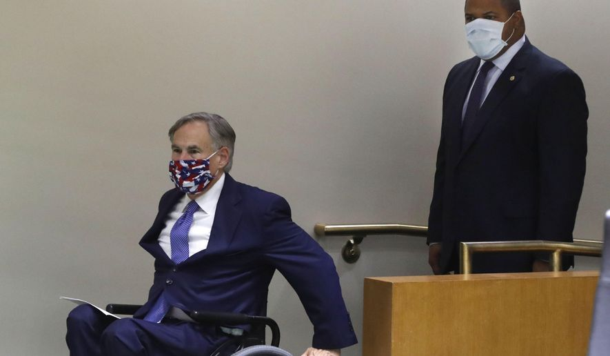 Amid concerns of the spread of COVID-19, Texas Gov. Greg Abbott, left, and Dallas Mayor Eric Johnson wear masks as they arrive to speak at a news conference at city hall in Dallas, Tuesday, June 2, 2020. Abbott and local officials were on hand to discuss the response to protests in Texas over the death of George Floyd. (AP Photo/LM Otero)