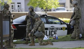 Utah National Guard members are shown, Monday, June 1, 2020, in Salt Lake City. Approximately 200 Utah National Guard members have been activated by order of Utah Governor, Gary R. Herbert, to assist local law enforcement agencies in response to violence and looting in downtown Salt Lake City to deter criminal activity and protect life and property. (AP Photo/Rick Bowmer)