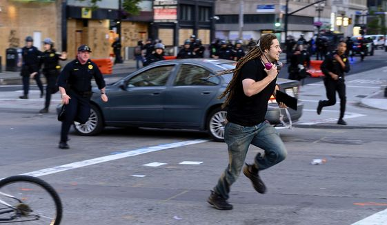 More Than 100 Charged With Looting Assaults In California Washington Times