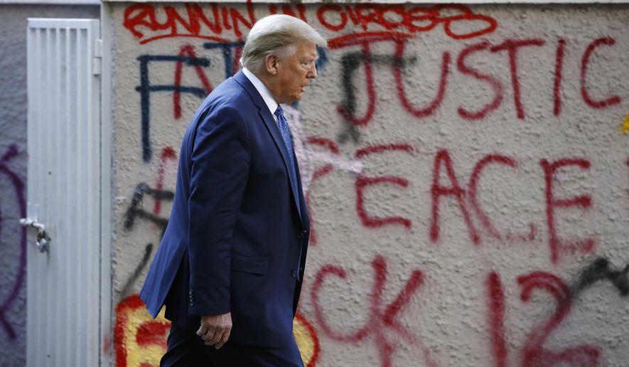 President Donald Trump walks from the White House through Lafayette Park to visit St. John's Church Monday, June 1, 2020, in Washington. (AP Photo/Patrick Semansky)