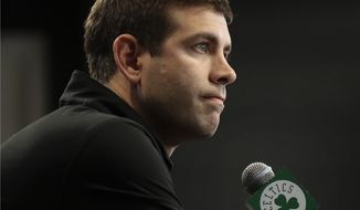 FILE - In this June 20, 2019, file photo, Boston Celtics coach Brad Stevens speaks during a news conference in Boston. Stevens says he supports the decisions of several of his players, including Jaylen Brown, Marcus Smart and Enes Kanter, who have taken part in recent protests following the death of George Floyd in Minneapolis. Stevens says he wrote a letter to his players letting them know he was with them and that he hopes the recent demonstrations around the country can help lead to healing and help to create sustainable change. (AP Photo/Elise Amendola, File)