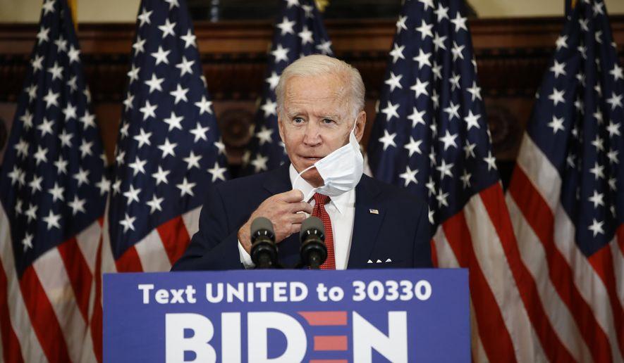 Democratic presidential candidate, former Vice President Joe Biden removes his mask as he speaks in Philadelphia, Tuesday, June 2, 2020. (AP Photo/Matt Rourke)