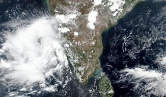 This May 31, 2020, satellite image released by NASA shows Cyclone Nisarga roaring toward the western coast of India. Indian Meteorological Department (IMD) authorities say that the cyclone brewing in the Arabian sea is expected to cross very close to India's western coast on Wednesday, June 3, 2020. Maharashtra and Gujarat states are on pre-cyclone alert as heavy rainfall is expected in the region. The city of Mumbai, already overwhelmed with the high incidence of coronavirus cases, is bracing for this unusual cyclone that may inundate low-lying slum areas. (NASA Worldview, Earth Observing System Data and Information System (EOSDIS) via AP)