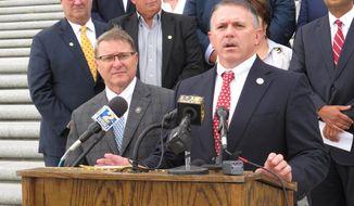 House Speaker Clay Schexnayder, R-Gonzales, right, speaks about the legislative session with Senate President Page Cortez, R-Lafayette, left, on Monday, June 1, 2020, in Baton Rouge, La. (AP Photo/Melinda Deslatte)