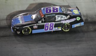 Brandon Brown (68) drives during NASCAR Xfinity Series auto race at Bristol Motor Speedway Monday, June 1, 2020, in Bristol, Tenn. (AP Photo/Mark Humphrey)