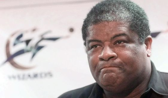 In this May 14, 1998, file photo, Washington Wizards general manager Wes Unseld announces the trade of Chris Webber to the Sacramento Kings for Mitch Richmond and Otis Thorpe at the MCI Center in Washington. Unseld died Tuesday, June 2, 2020, after a series of health issues, most recently pneumonia. The Washington Wizards will honor him with a #41 patch worn on players' uniforms throughout the rest of the 2020 season. (AP Photo/Brian K. Diggs) ** FILE **