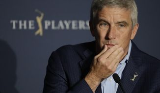 In this March 13, 2020, file photo, PGA Tour Commission Jay Monahan is shown during a news conference in Ponte Vedra Beach, Fla. Monahan decided against a public statement on the civil unrest sparked by the police killing of George Floyd, instead sending a letter to players. (AP Photo/Chris O'Meara, File)  **FILE**