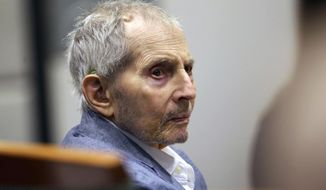 FILE - In this March 10, 2020, file photo, real estate heir Robert Durst looks over during his murder trial in Los Angeles. Los Angeles County prosecutors are opposing a motion from Durst for a mistrial in the murder trial of the 77-year-old New York real estate heir. Prosecutors say in their motion Tuesday, June 2, 2020, that Durst is using the coronavirus pandemic to further delay facing a charge of killing his best friend, Susan Berman, in her Beverly Hills home in 2000, and jurors will be perfectly able to resume their duties. Durst has denied any role in the killing. (AP Photo/Alex Gallardo, Pool, File)