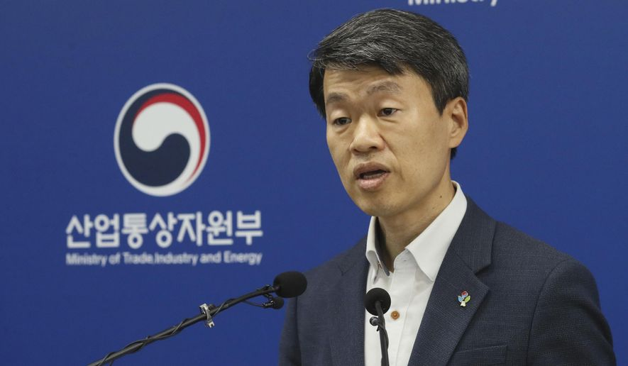 Na Seung-sik, deputy minister of the Ministry of Trade, Industry and Energy's Office of Trade and Investment, speaks during a briefing at the government complex in Sejong, South Korea, Tuesday, June 2, 2020. Reigniting a bitter row between key U.S. allies, South Korea on Tuesday said it will reopen a complaint filed with the World Trade Organization over Japan's tightened controls on technology exports to its companies, blaming Tokyo for an alleged lack of commitment in resolving mutual grievances. (Kang Jong-min/Newsis via AP)