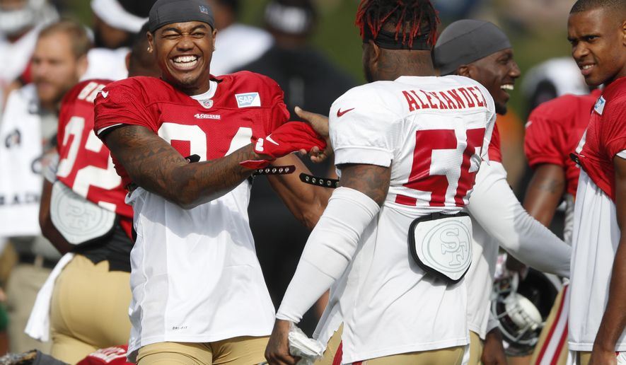 FILE - In this Aug. 16, 2019, file photo, San Francisco 49ers wide receiver Kendrick Bourne, left, jokes with middle linebacker Kwon Alexander during a combined NFL football training camp with the Denver Broncos at the Broncos' headquarters in Englewood, Colo. All 32 NFL teams have been told by Commissioner Roger Goodell to hold training camps at their home facilities this summer because of the COVID-19 pandemic. Most NFL teams stay at their training complexes year-round, but Dallas, Pittsburgh, Kansas City and Buffalo are among those that stage training camp elsewhere.  (AP Photo/David Zalubowski, File)