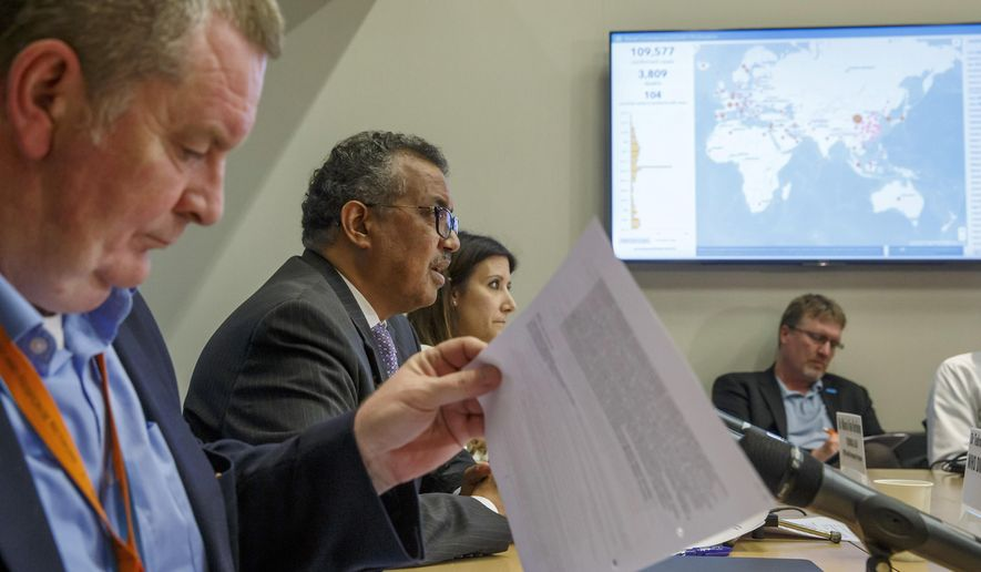 In this Monday, March 9, 2020, file photo, Tedros Adhanom Ghebreyesus, second left, director-general of the World Health Organization, speaks during a news conference on updates regarding the new coronavirus at WHO headquarters in Geneva, Switzerland. At left is Michael Ryan, executive director of WHO's Health Emergencies program, and at third left is Maria van Kerkhove, technical lead of WHO's Health Emergencies program. Two days later, the WHO declared the new coronavirus a pandemic, suggesting the disease is spreading across the globe unchecked. WHO staffers debated how to press China for gene sequences and detailed patient data without angering authorities, worried about losing access and getting Chinese scientists into trouble. (Salvatore Di Nolfi/Keystone via AP)