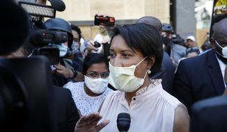 District of Columbia Mayor Muriel Bowser speaks to the media as demonstrators gather to protest the death of George Floyd, Wednesday, June 3, 2020, near the White House in Washington. Floyd died after being restrained by Minneapolis police officers. (AP Photo/Alex Brandon)