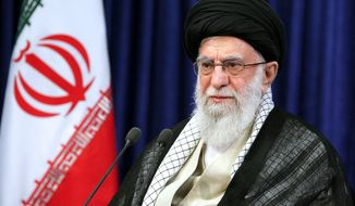 In this picture released by the official website of the office of the Iranian supreme leader, Supreme Leader Ayatollah Ali Khamenei addresses the nation in a televised speech marking the anniversary of the 1989 death of Ayatollah Ruhollah Khomeini, the leader of the 1979 Islamic Revolution, in Tehran, Iran, Wednesday, June 3, 2020. Khamenei assailed Washington in the wake of George Floyd's killing for its allegedly duplicitous policies when it comes to upholding human rights. (Office of the Iranian Supreme Leader via AP)