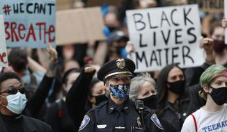 Westbrook Police Chief Janine Roberts attends a rally to peacefully protest and demand an end to institutional racism and police brutality, Wednesday, June 3, 2020, in Portland, Maine. (AP Photo/Robert F. Bukaty) ** FILE **