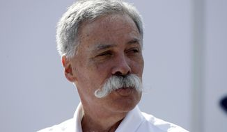 FILE - In this Saturday, Sept. 7, 2019 file photo, CEO of the Formula One Group, Chase Carey arrives prior to the third free practice at the Monza racetrack, in Monza, Italy. Formula One races won't be canceled if a driver tests positive for the coronavirus or if a team withdraws, CEO Chase Carey says. F1 is keen to avoid a repeat of the season opener in Australia in March, which was canceled when McLaren withdrew after a staff member tested positive for the virus. The season is now set to start with two races in Austria on July 5 and 12. (AP Photo/Luca Bruno, File)