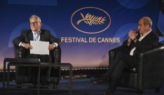 """Cannes Festival director Thierry Fremaux, left, festival president Pierre Lescure, sit during the presentation of the festival lineup, in an empty cinema Wednesday, June 3, 2020 in Paris. The Cannes Film Festival was canceled due to the pandemic but it announced the films that would have played at the French Riviera festival. Those films, festival organizers say, will be able to promote themselves with the Cannes """"stamp of approval."""" (Serge Arnal, Pool via AP)"""