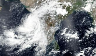 This Tuesday, June 2, 2020, satellite image released by NASA shows Cyclone Nisarga roaring toward the western coast of India. The cyclone is forecast to make landfall Wednesday, June 3, 2020, afternoon on the country's west coast near Mumbai, a coastal city home to 18.4 million people and known for the Bollywood film industry. Mumbai hasn't been hit by a cyclone in more than a century, raising concern about its readiness. (NASA Worldview, Earth Observing System Data and Information System (EOSDIS) via AP)