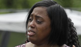 "Demetree Wynn, mother of Dreasjon ""Sean"" Reed, speaks during a news conference, Wednesday, June 3, 2020, in Indianapolis. The family of Reed, a black man who was fatally shot by an Indianapolis police officer, called Wednesday for the federal government to intervene and conduct its own probe of his death, with a family attorney saying that city police ""are trying to conceal information."" (AP Photo/Darron Cummings)"
