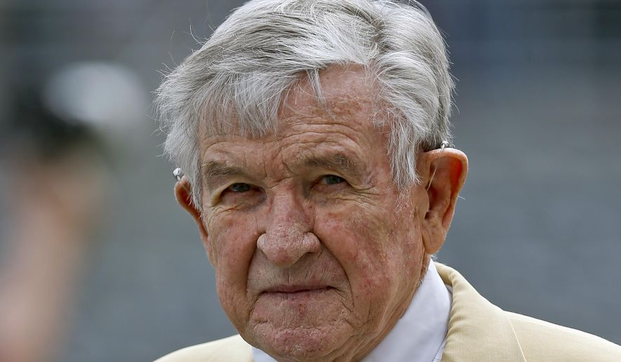 FILE - In this April 14, 2018, file photo, Blue team coach Johnny Majors, a former Pittsburgh NCAA college football coach, is shown before the annual Blue Gold game in Pittsburgh. Majors, the coach of Pittsburgh's 1976 national championship team and a former coach and star player at Tennessee, has died. He was 85. Majors died Wednesday morning, June 3, 2020, at home in Knoxville, Tenn., according to a statement from his wife, Mary Lynn Majors.(AP Photo/Keith Srakocic, File)