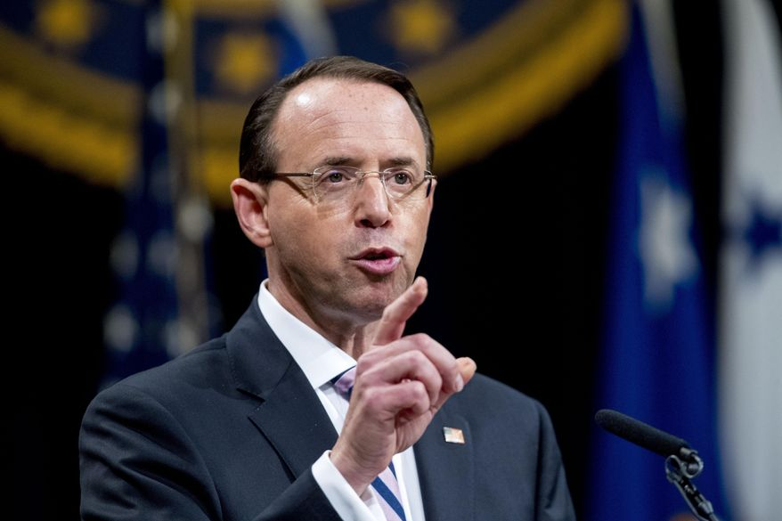 In this May 9, 2019, file photo, then-Deputy Attorney General Rod Rosenstein speaks during a farewell ceremony in the Great Hall at the Department of Justice in Washington. Senate Republicans are planning to press Rosenstein on his oversight of the Russia investigation in the first in a series of oversight hearings that coincides with accelerated election-year efforts to scrutinize the FBI probe. (AP Photo/Andrew Harnik, File)