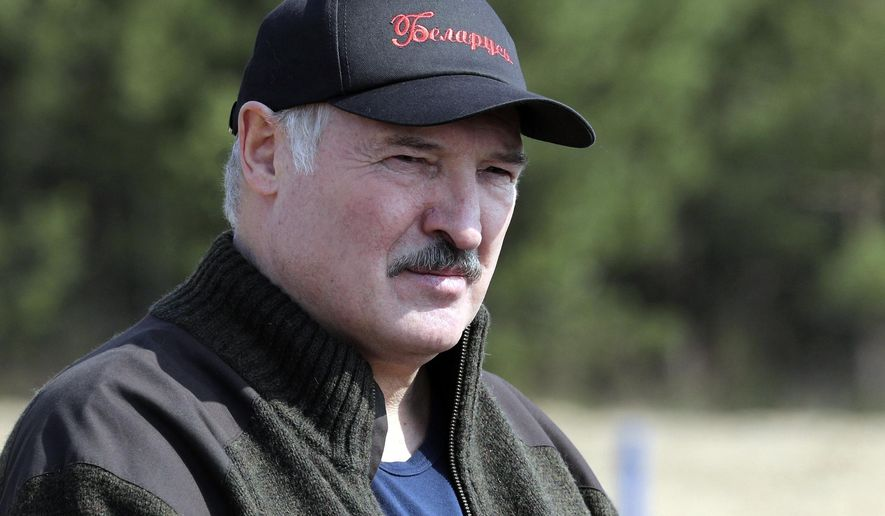 FILE - In this Saturday, April 25, 2020 file photo, Belarus President Alexander Lukashenko attends a subbotnik, a Soviet-style Clean-up Day, in the village of Liaskovichi, about 270 km (169 miles) south of Minsk, Belarus. Belarusia's authoritarian president has dismissed his cabinet two months ahead of presidential elections. President Alexander Lukashenko, who is seeking a sixth term in the August 9 election, said Wednesday June 3, 2020, that most ministers would retain their positions in the new government to be named before the vote. (Maxim Guchek/BelTA Pool Photo via AP, File)