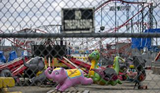 Amusement rides sits idle at Palace Playland, Wednesday, June 3, 2020, in Old Orchard Beach, Maine. Reopening plans remain uncertain but the amusement park hopes to open the arcade in mid-June and possibly get the rides going a week or so later. (AP Photo/Robert F. Bukaty)