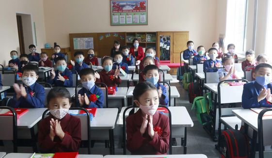 Students wearing face masks take a class at Kim Song Ju Primary School in Pyongyang, North Korea, Wednesday, June 3, 2020. All the schools in the country start their lessons this month after delays over concern about the new coronavirus. (AP Photo/Cha Song Ho)  **FILE**
